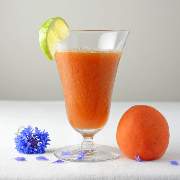 apricot cocktail with blue flower and apricot