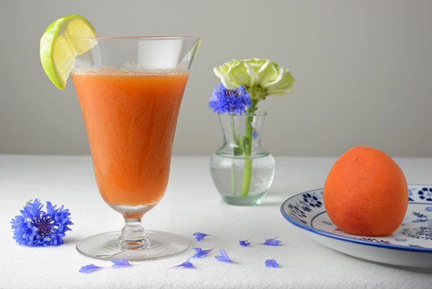 apricot cocktail with blue flowers