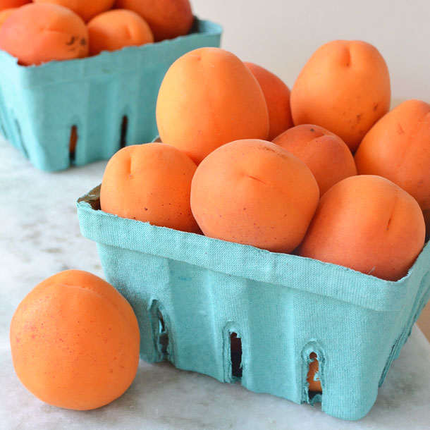 fresh apricots in green boxes