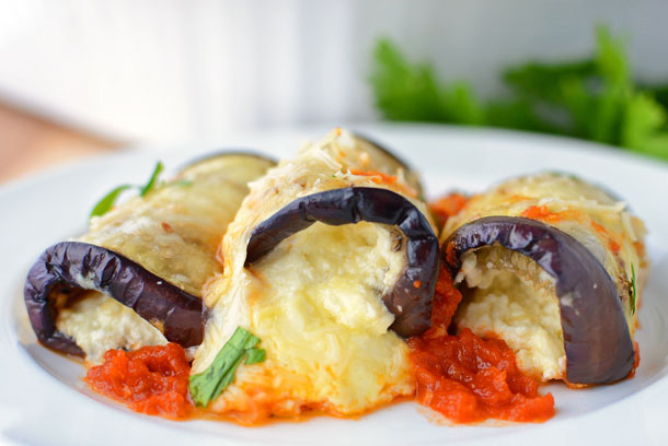 This amazing, lightened-up Italian dish combines the flavors of eggplant parmesan and stuffed shells. This recipe is one of our favorites because it's naturally lighter, yet still BURSTING with cheesy goodness!