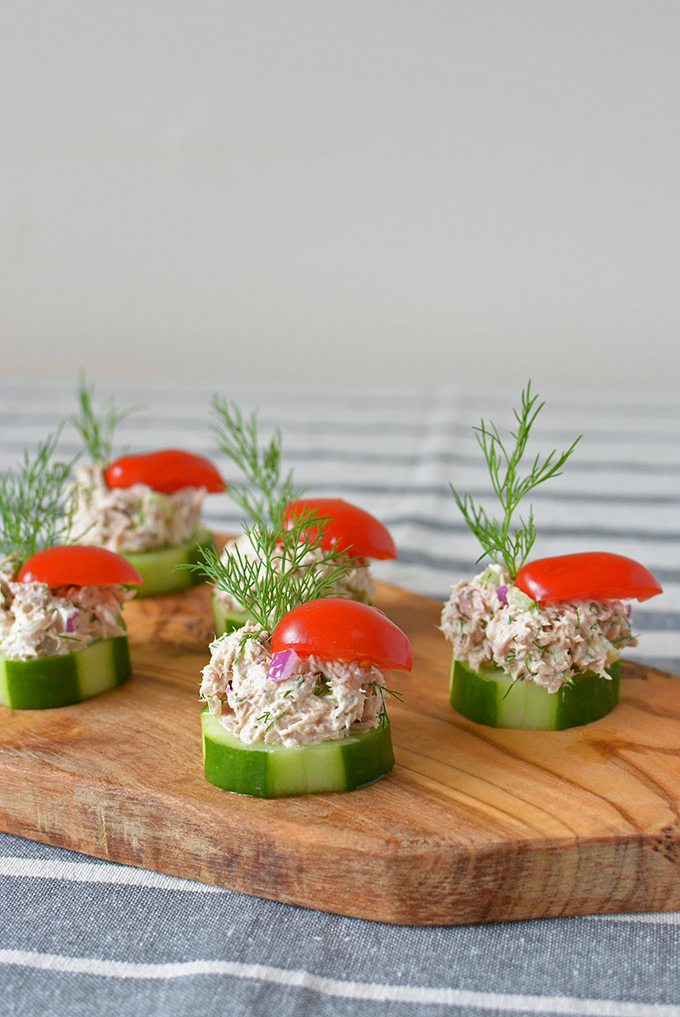 Cucumber Tuna Salad Bites - When the summer heat is at its peak, sometimes you just don't feel like cooking. Thankfully, these tasty little party appetizers are cool, crunchy, and require ZERO oven time! | SimpleSeasonal.com