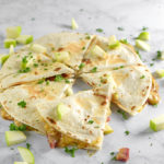 Honey Ham, Gouda, and Apple Quesadillas - Trying to figure out what to do with that leftover ham? Turn it into a quick, easy, and delicious appetizer with this fun spring recipe!