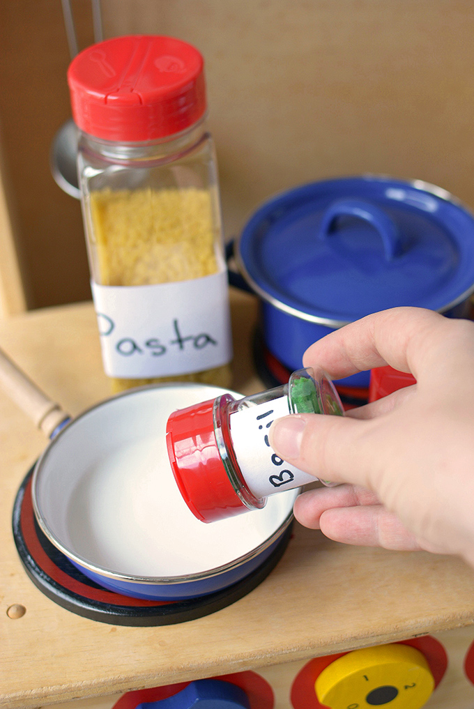 Play Kitchen Upcycled Spice Jars - Give your empty spice jars a new life with this fun craft for kids that will encourage conservation and imaginative play!