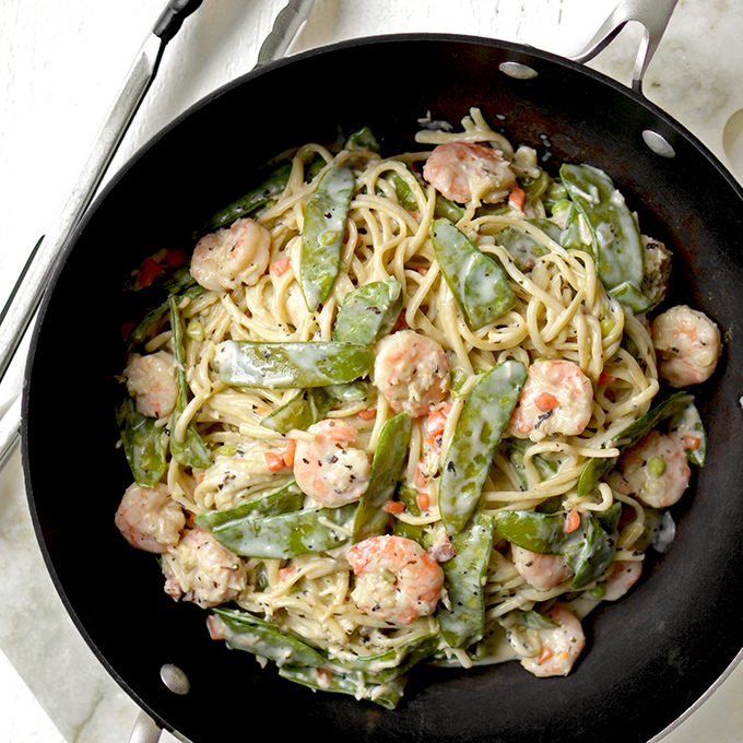 One-Pot Shrimp and Snow Pea Alfredo Pasta - Comfort food meets fresh spring veggies in this simple, creamy, and delicious Italian dinner.