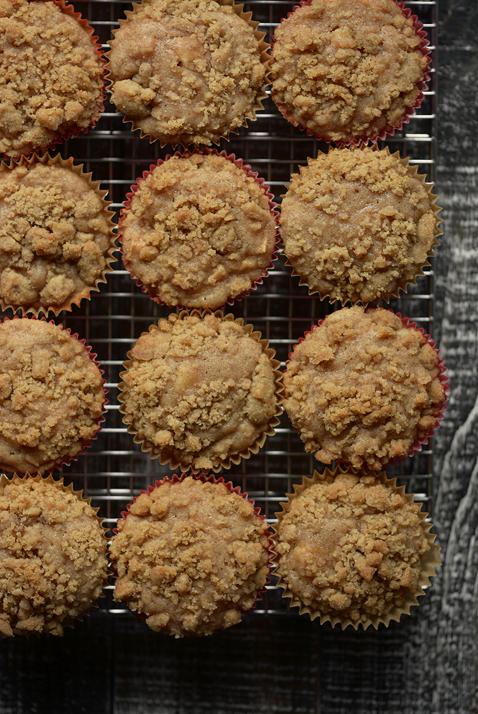 apple cinnamon streusel muffins on a cooling rack