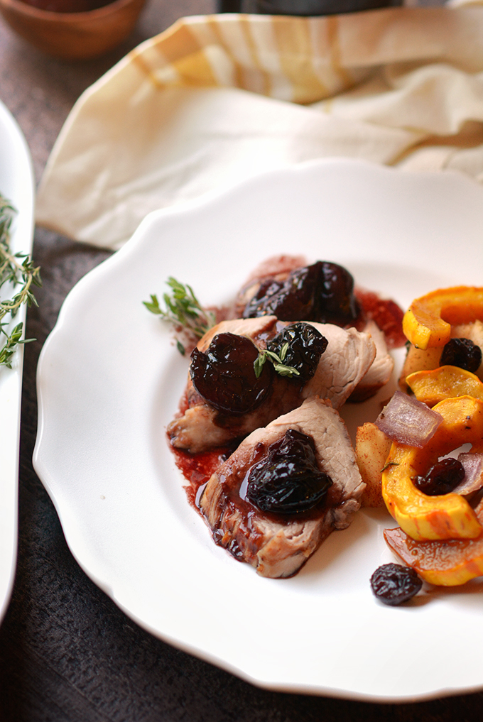 Closeup of pork tenderloin with cherry sauce