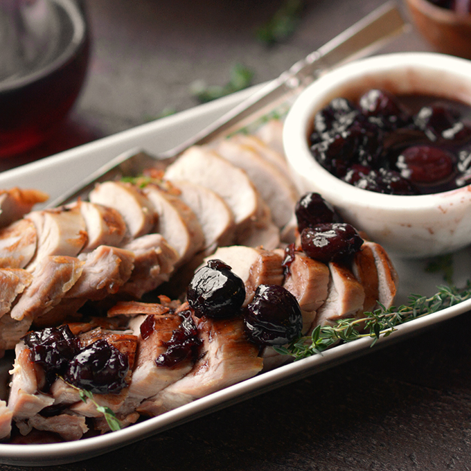 pork tenderloin with cherry sauce on a plate