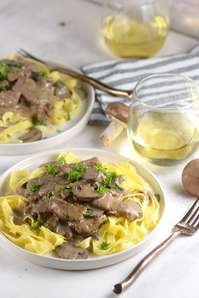 plate-of-beef-stroganoff-and-noodles-and-wine