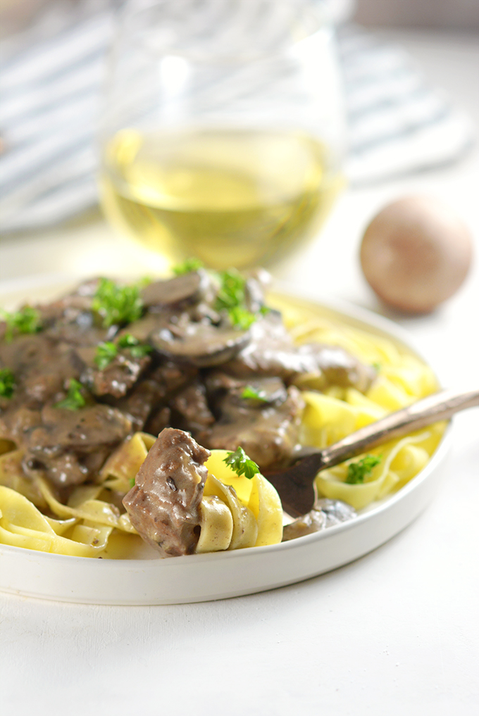 bite-of-beef-stroganoff-on-fork-with-pasta