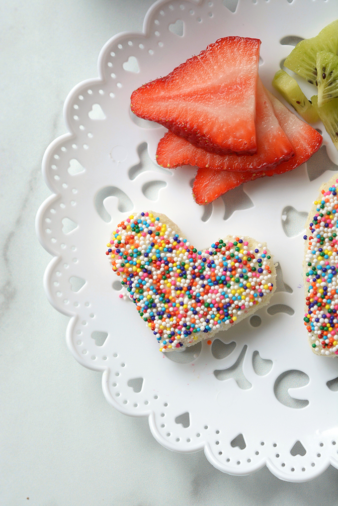 Close-Up Overhead Shot of Heart Shaped Fairy Bread with a Side of Strawberries