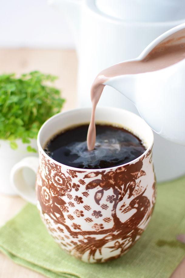 Pouring Irish coffee creamer