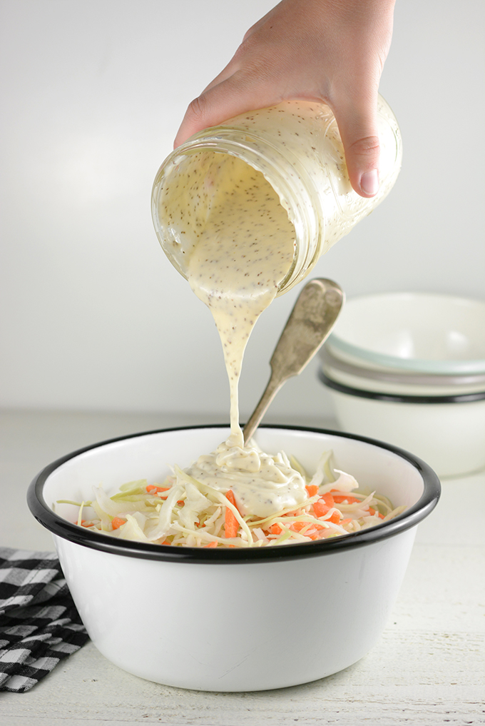 Pouring dressing onto a 14-16 oz Bag of Coleslaw Mix